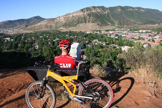 mountain biker surveying durango colorado real estate